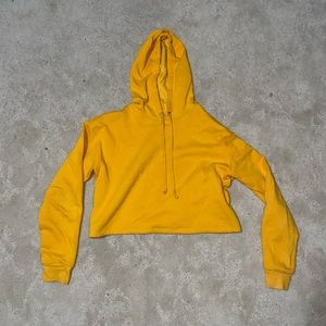 Divided gold cropped hoodie